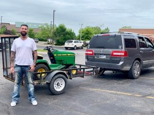 Marcus with the donated lawnmower