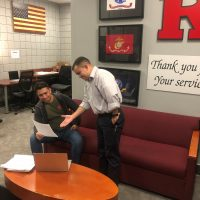 Photo of Augusto Cumpa (left) with Paul Lazaro, assistant director of the Office of Veterans Affairs at Rutgers-Newark.