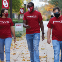 Three student veterans walking together