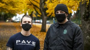 Two student veterans standing together with their masks on