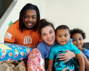 Student veteran Jeff Wilson smiling for a picture with his wife and two children