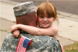 father-holding-daughter-holding-flag_cropped