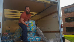Last fall, the Student Veterans Organization collected supplies for victims of Hurricane Harvey. Marine Michael Bearth helped unload three pallets of water bottles to send to Houston