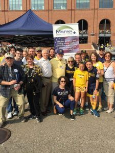 A group of M-SPAN staff members and supporters at UM Football game tailgate