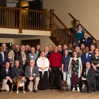 Photo of about 40 Buddy-to-Buddy Program volunteers posed as a group. Photo taken at annual Volunteer Recognition Event on April 13, 2019 in Clare, Michigan.