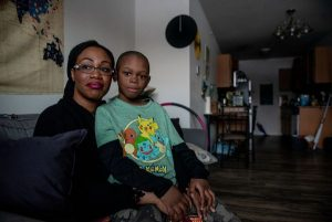 Photo of Krystle DuPree and her son Tytus pose for a portrait at their home on Monday, March 4, 2019 in Pittsfield Township. DuPree she is looking for a more affordable place to live. (Ben Allan Smith | MLive.com)
