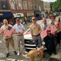 Picture of Buddy-to-Buddy volunteers and staff walking in the 4th of July Parade