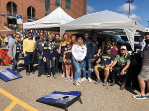 Group photo of M-SPAN friends and staff at 2019 UM Football Military Appreciation Game tailgate