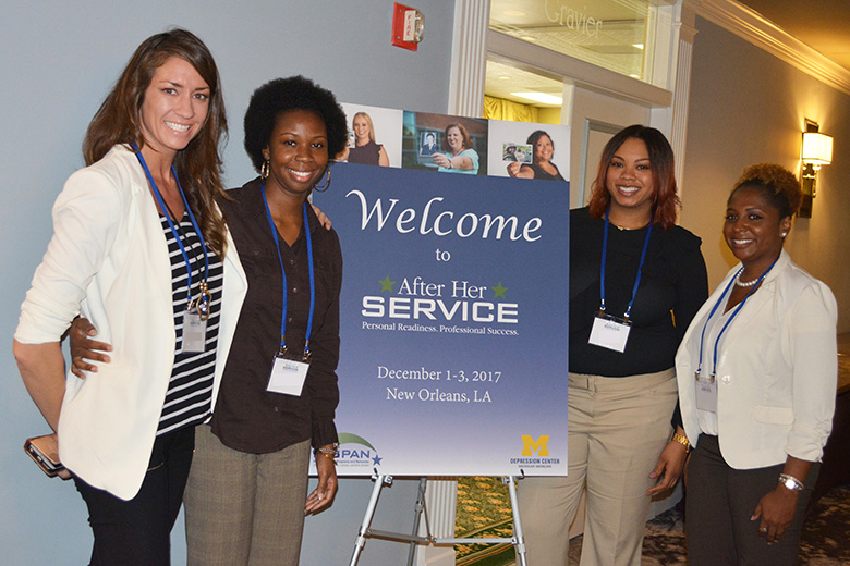 Photo of four After Her Service participants standing and smiling together at their AHS retraeat