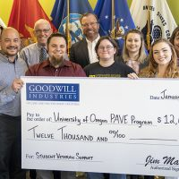 Photo of University of Oregon PAVE Program team receiving a $12,000 check from Goodwill Industries