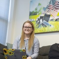 Student Veteran Katie Yetter smiling for a picture in an office