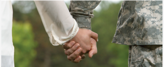 Photo of two hands holding--one of a woman's hand, the other hand that of a service member in uniform